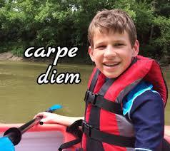 "Photo of Kyle Plush in boat with caption, ""carpe diem"""
